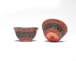 A VERY RARE PAIR OF IMPERIAL INSCRIBED CINNABAR LACQUER CARVED TEA BOWLS Qianlong seal marks and ...