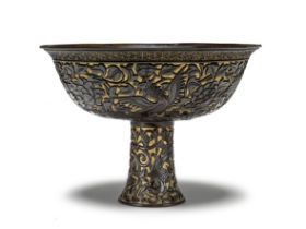 A VERY RARE GILT AND BROWN LACQUER 'PHOENIX AND CHILONG' STEM BOWL 15th/16th century