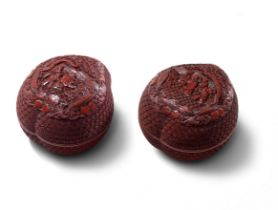 A PAIR OF CINNABAR LACQUER CARVED PEACH-SHAPED 'DAOIST IMMORTALS' BOXES AND COVERS Qianlong (4)