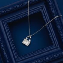 A WHITE GOLD AND DIAMOND CONSTANCE AMULETTE NECKLACE Hermès, 2021 (includes box and certific...