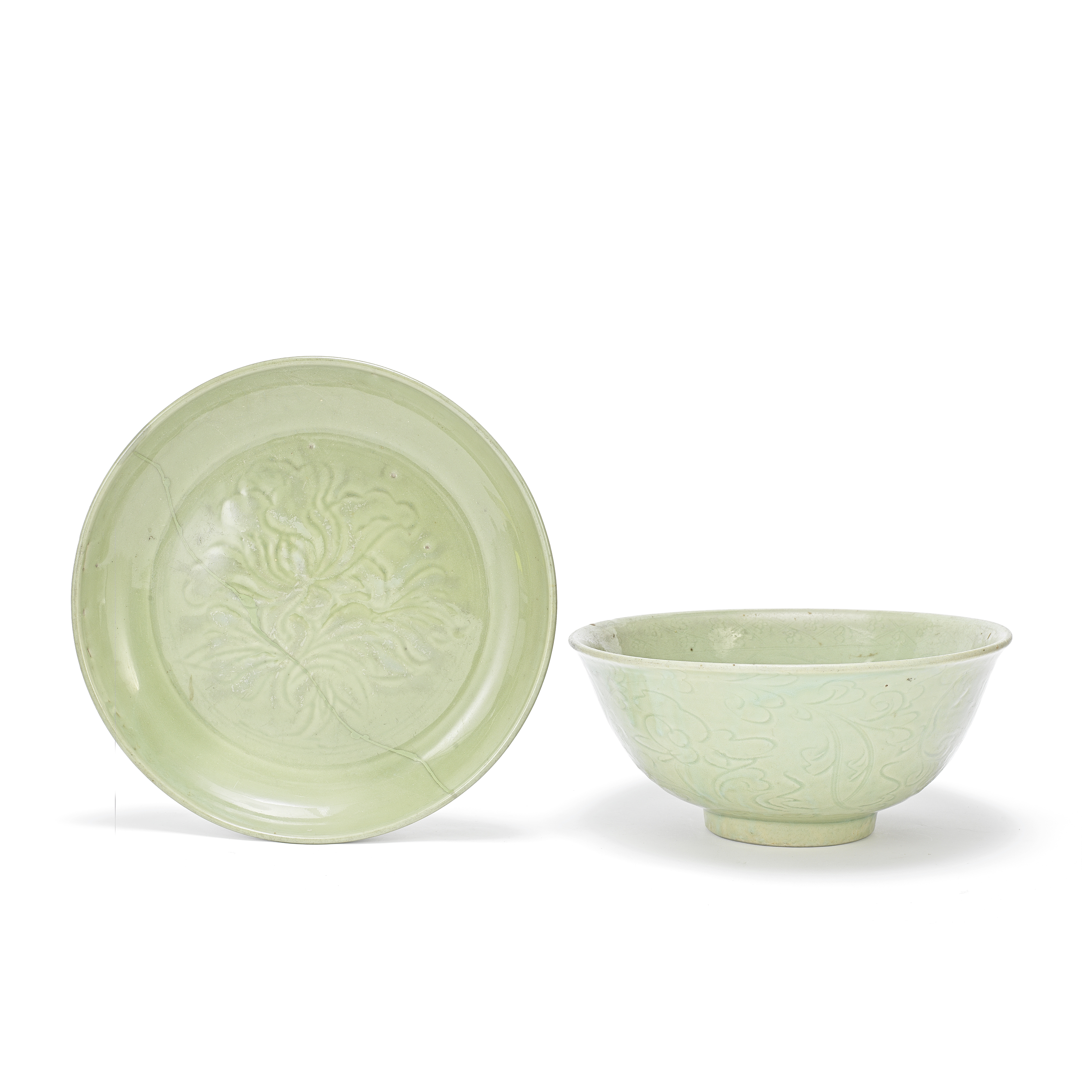 A CARVED LONGQUAN CELADON-GLAZED DEEP BOWL AND A LONGQUAN CELADON-GLAZED 'LOTUS' DISH Early Ming ...
