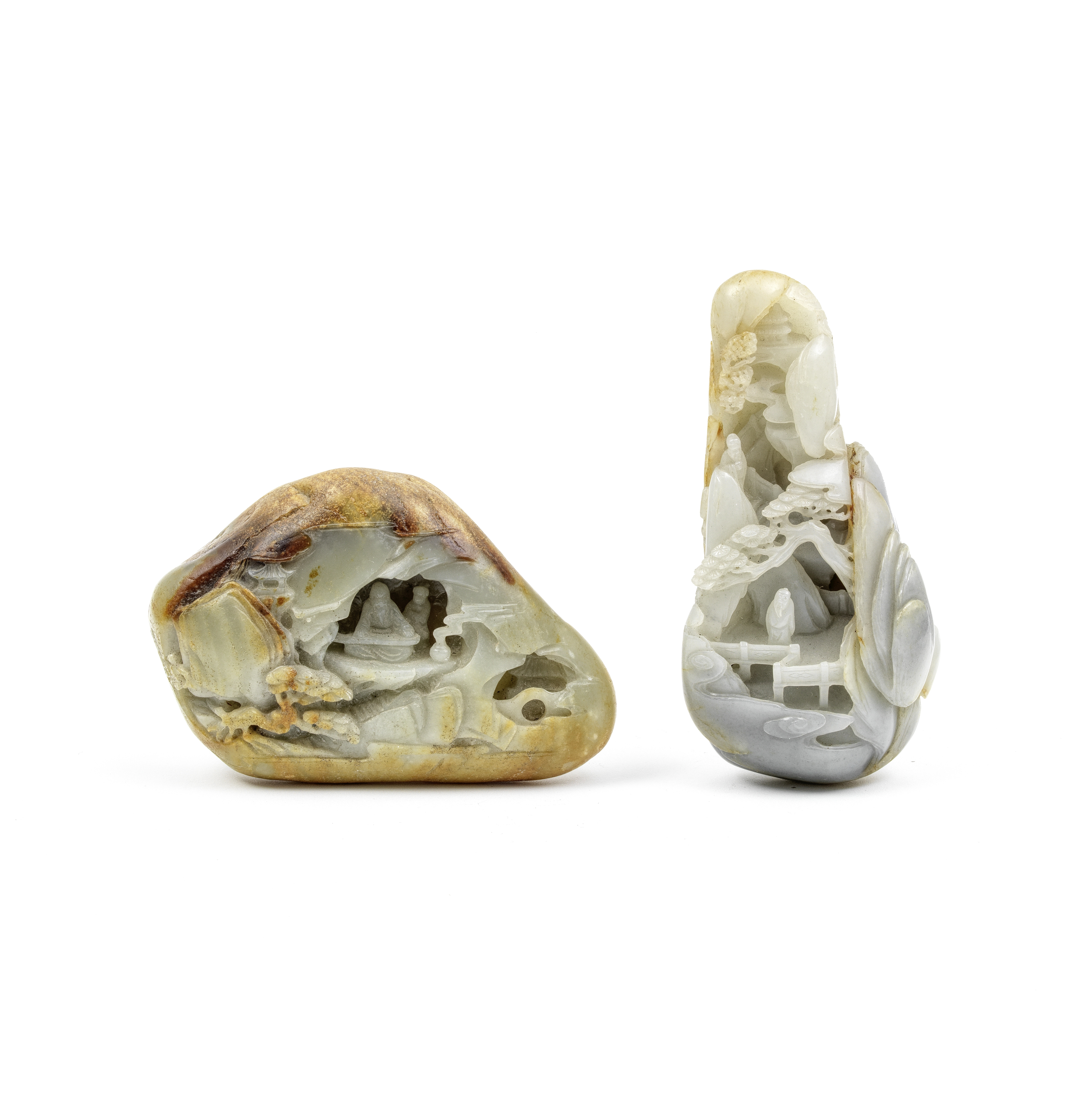 TWO PALE GREEN AND RUSSET JADE BOULDERS (2)