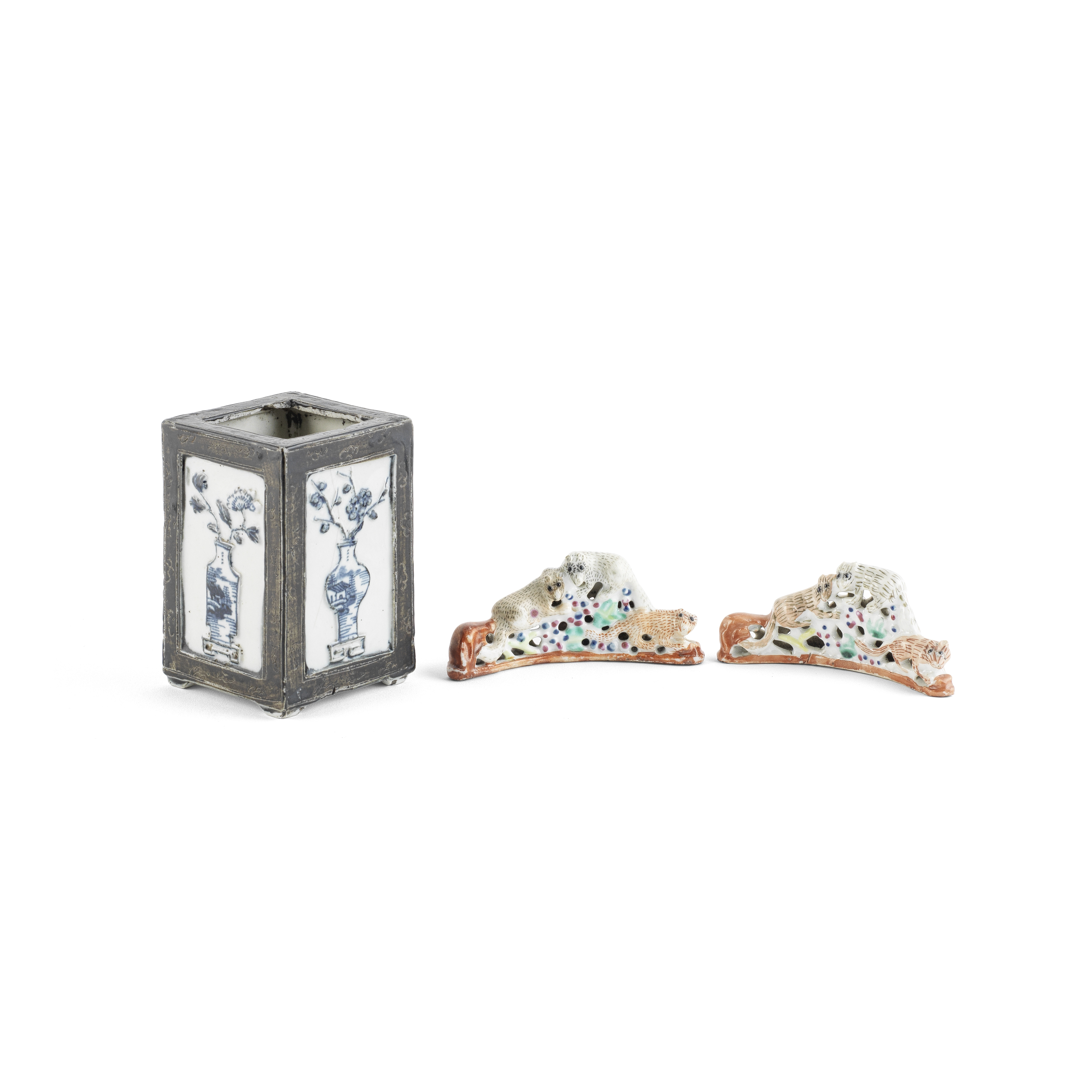 TWO FAMILLE ROSE 'SQUIRREL AND GRAPEVINE' BRUSH RESTS AND A BLUE AND WHITE MOULDED BRUSH POT 18th...