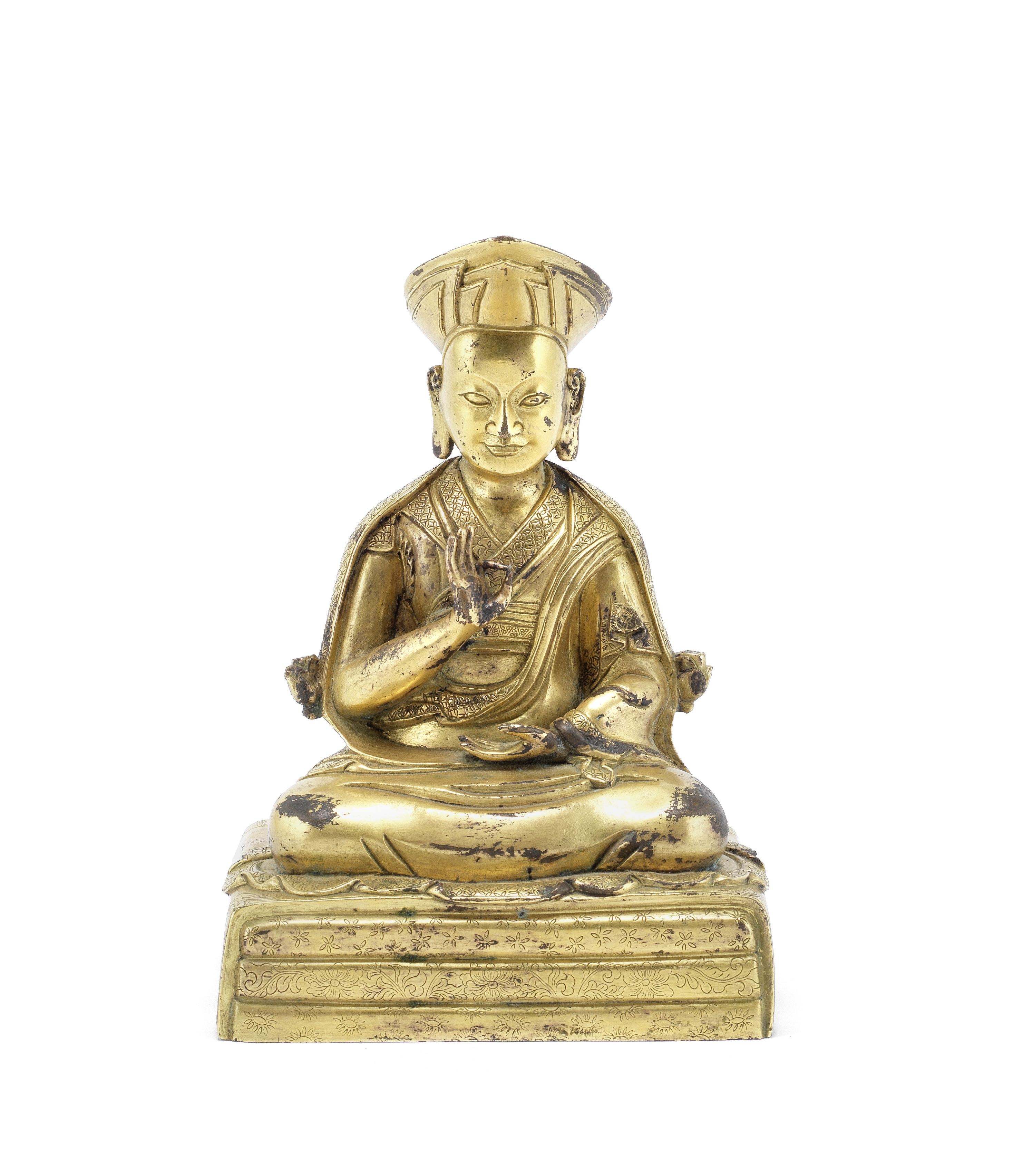 A GILT-BRONZE COPPER-ALLOY FIGURE OF A LAMA Tibet, possibly 18th century