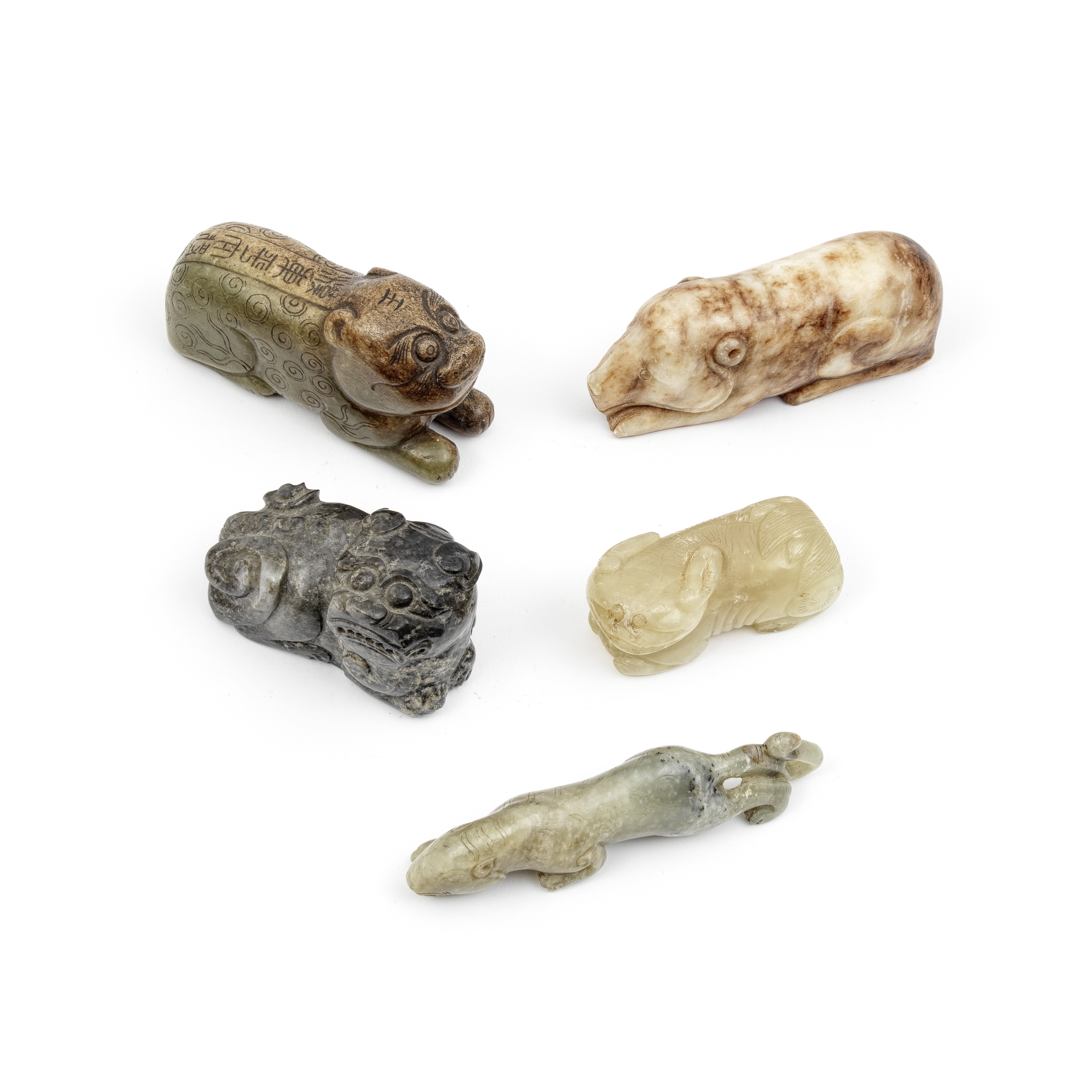 A GROUP OF FOUR JADE ANIMALS AND A HARSTONE BEAR The jade Buddhist lion, possibly Qing Dynasty (5)