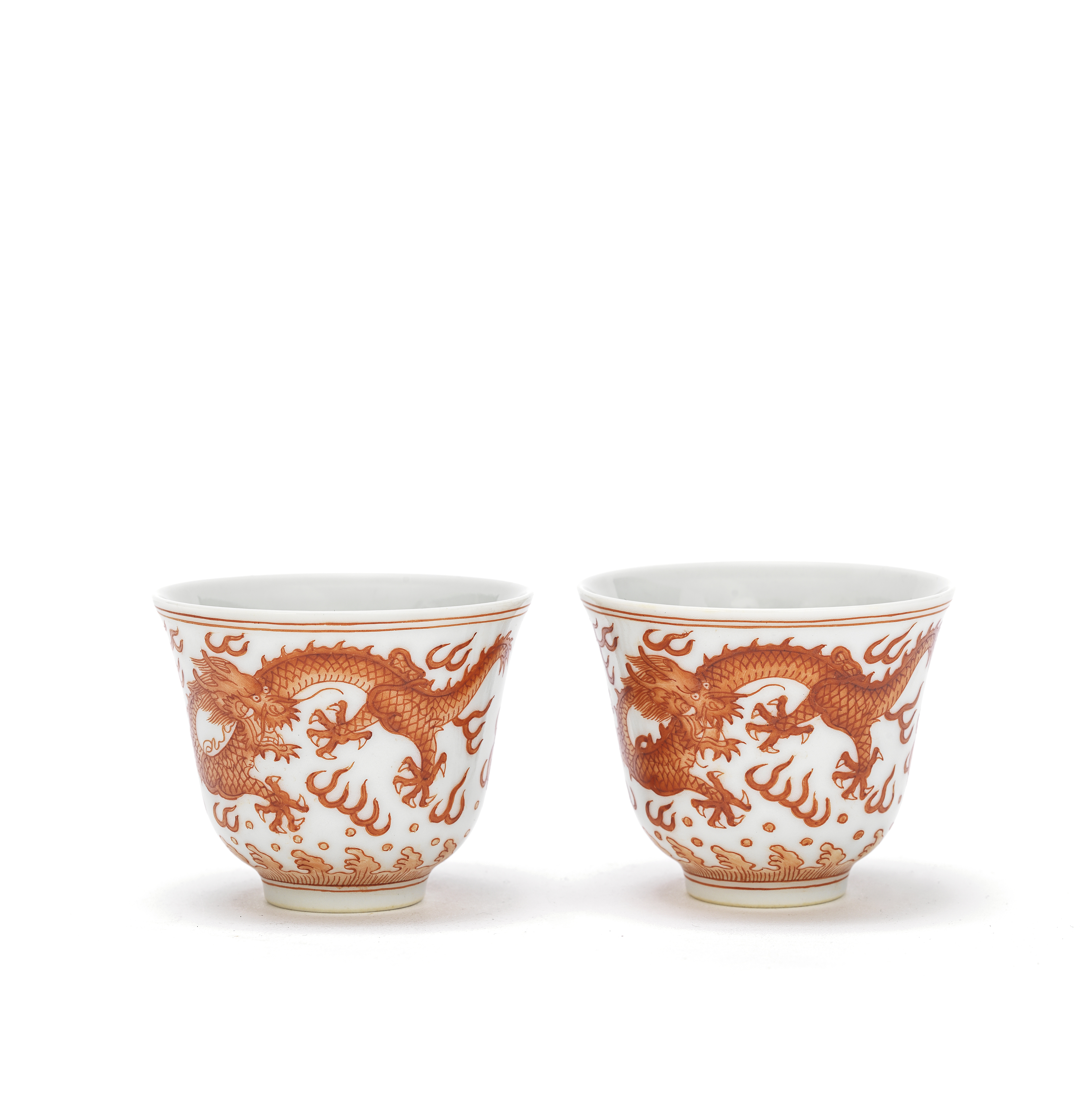 A PAIR OF IRON-RED 'DRAGON' CUPS Tongzhi six-character marks and possibly of the period (2)