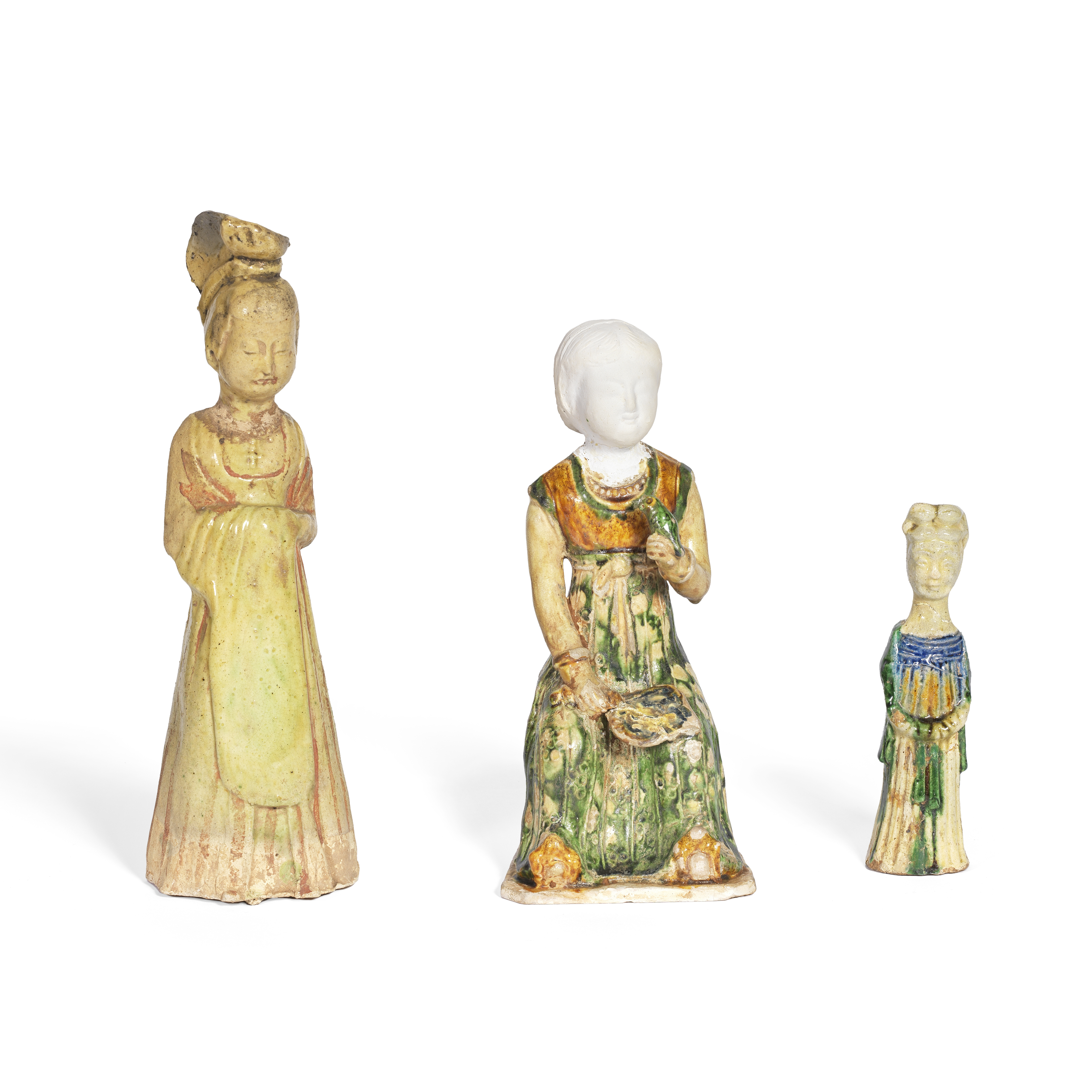 A GROUP OF THREE POTTERY LADIES Tang Dynasty and part later (6)