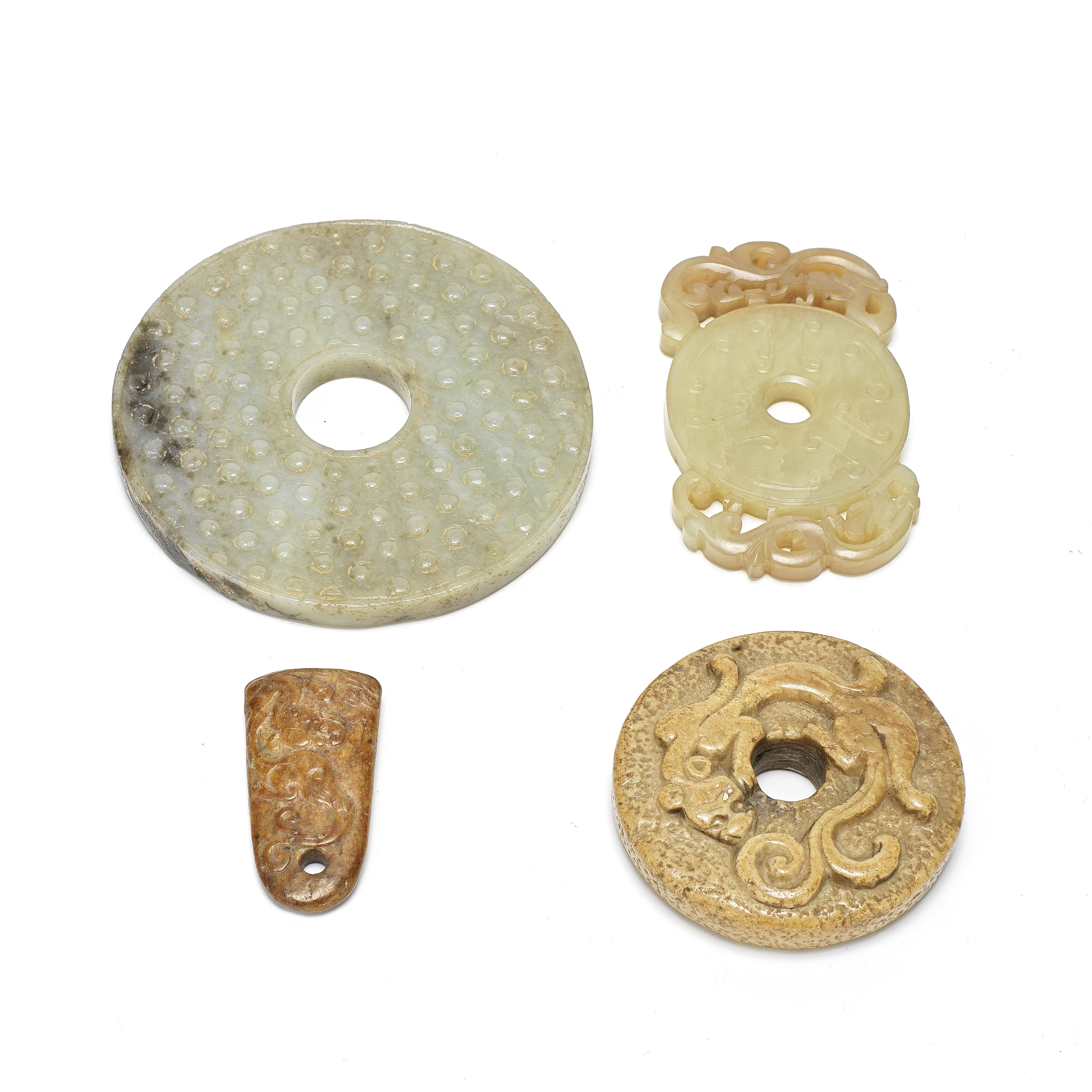 FOUR ARCHAISTIC JADE CARVINGS, THREE BI DISCS AND AN AXE PENDANT Song Dynasty and later (4)