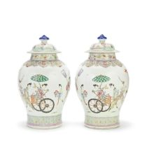 A MIRRORED PAIR OF FAMILLE ROSE 'LADIES AND DEER' JARS AND COVERS 18th/19th century (4)