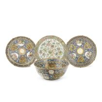 A CANTON FAMILLE ROSE PUNCHBOWL AND A PAIR OF DISHES FROM THE SERVICE OF SULTAN MAS'UD MIRZA ZILL...