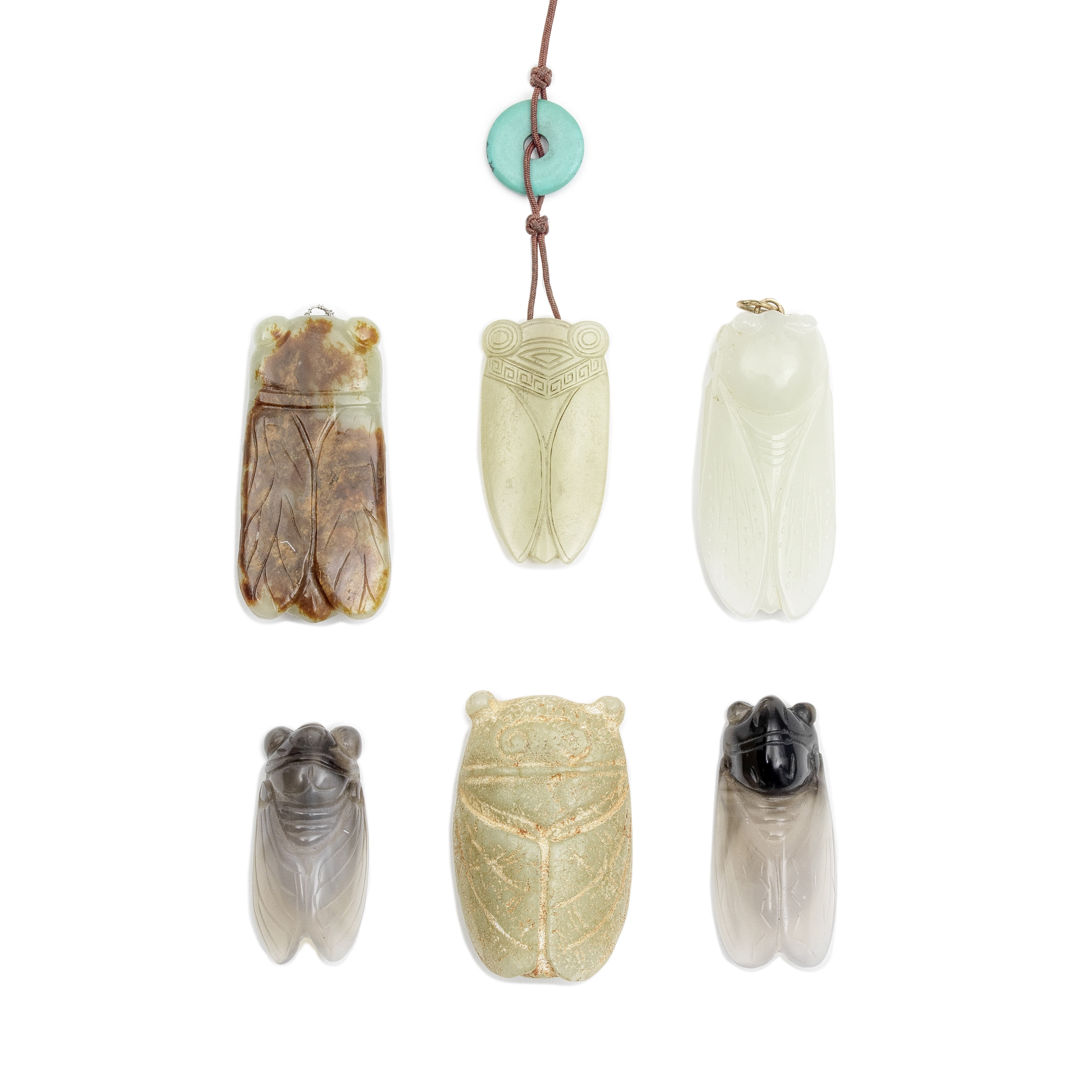 A GROUP OF FOUR JADE AND TWO AGATE 'CICADA' PENDANTS (6)