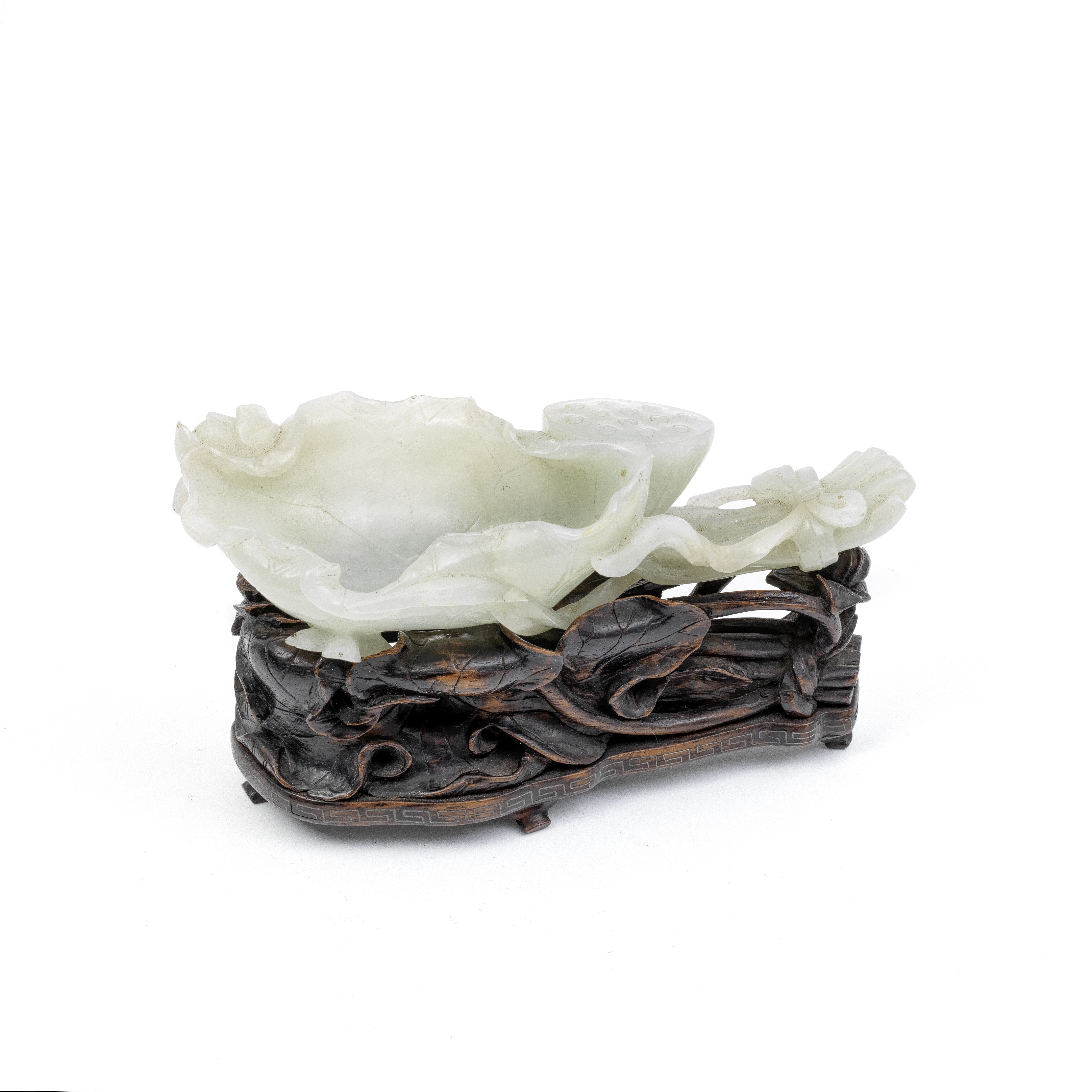 A JADE 'LOTUS' BRUSH WASHER AND WOOD STAND 19th century (2)