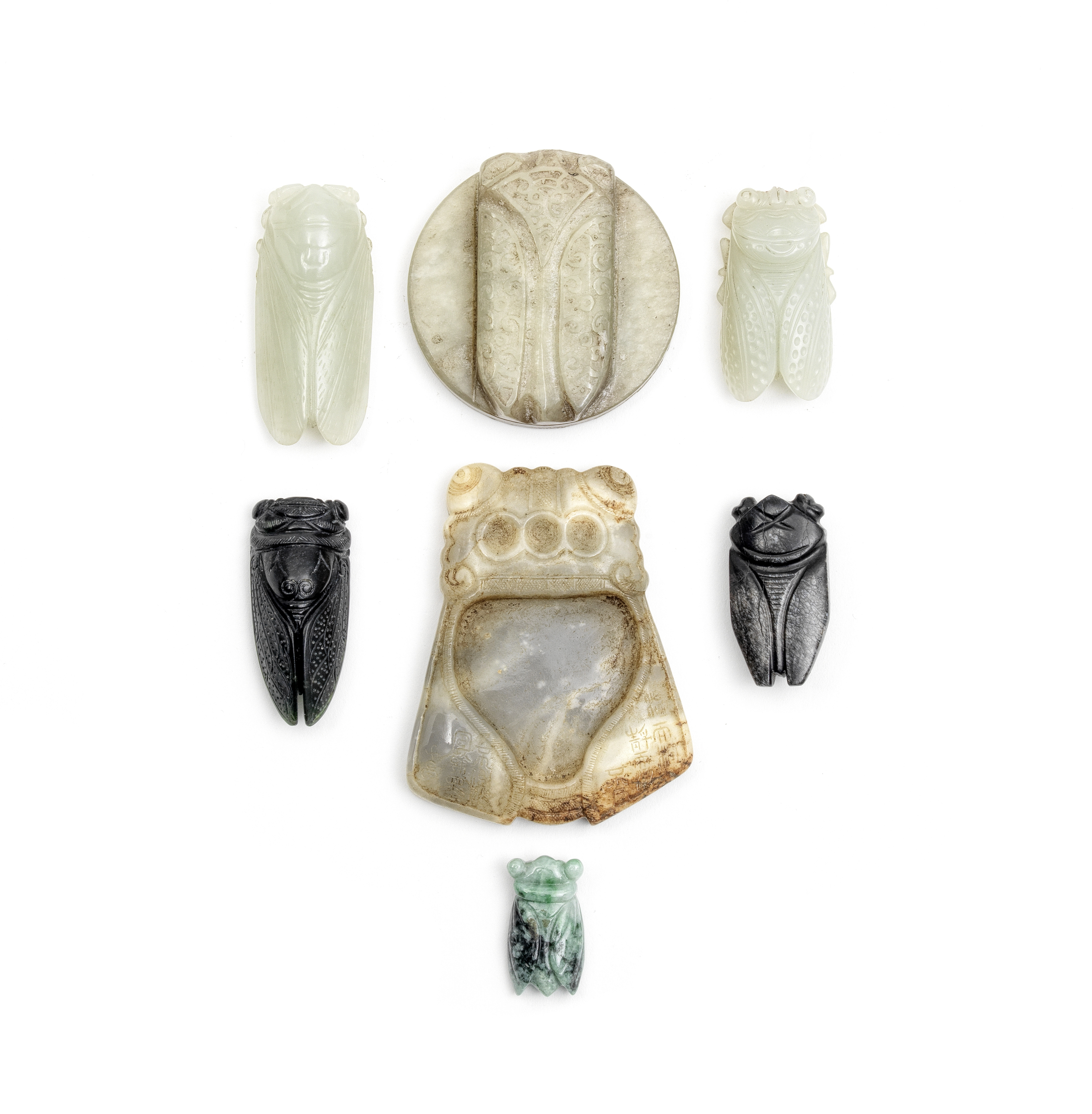 A GROUP OF SEVEN JADE AND ONE JADEITE CICADAS Late Qing Dynasty and later (7)