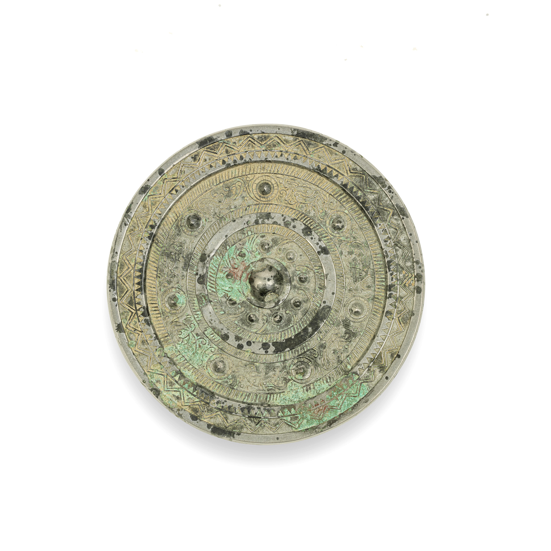 A SILVERED BRONZE MIRROR Han Dynasty