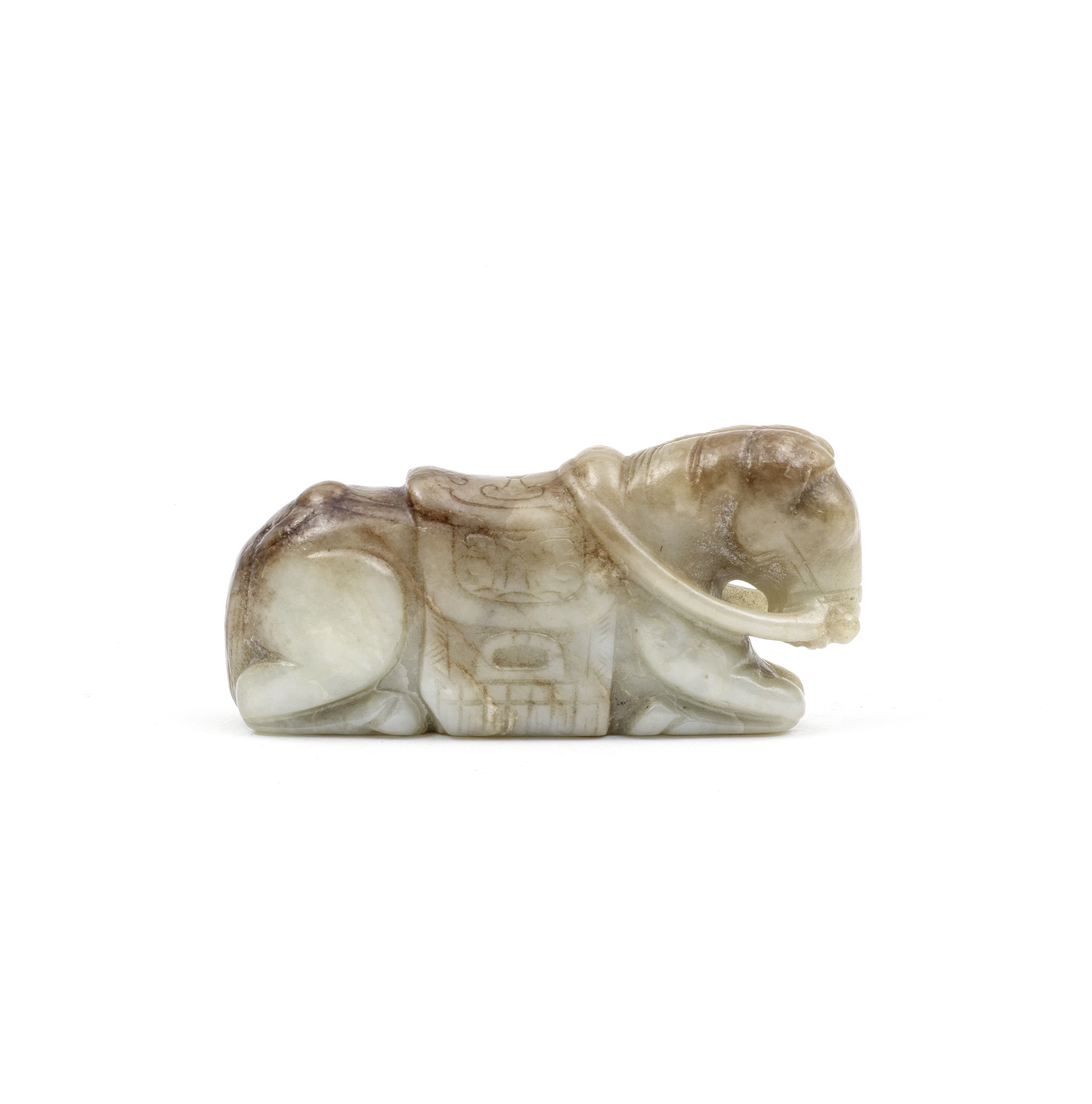 A PALE GREEN AND RUSSET JADE CARVING OF A RECUMBENT HORSE Ming Dynasty (2)