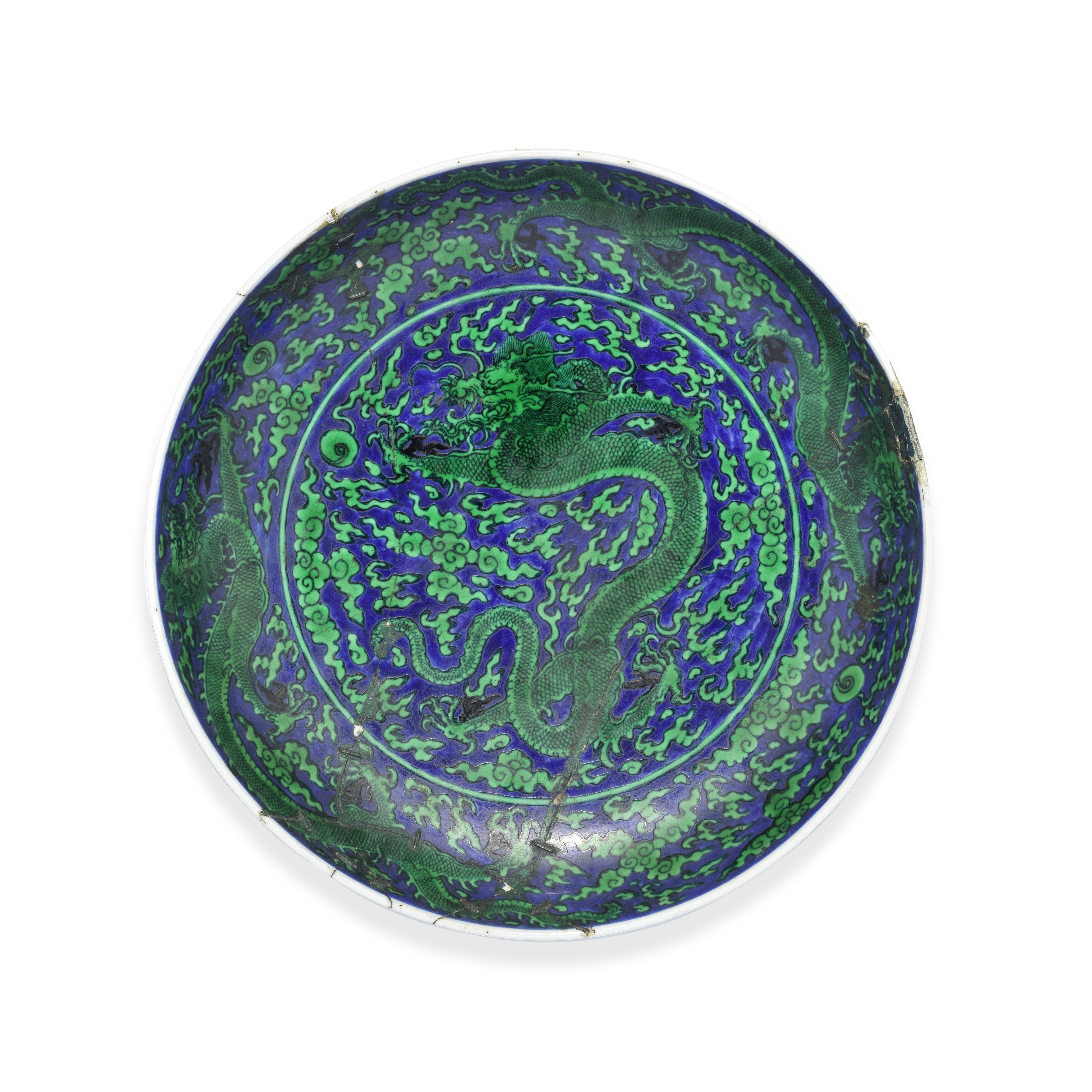 A FINE BLUE-GROUND GREEN-ENAMELLED 'DRAGON' DISH Kangxi six-character mark and of the period (2)