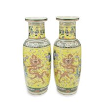 A LARGE PAIR OF FAMILLE ROSE YELLOW-GROUND 'FIVE DRAGON' ROULEAU VASES 19th century (2)