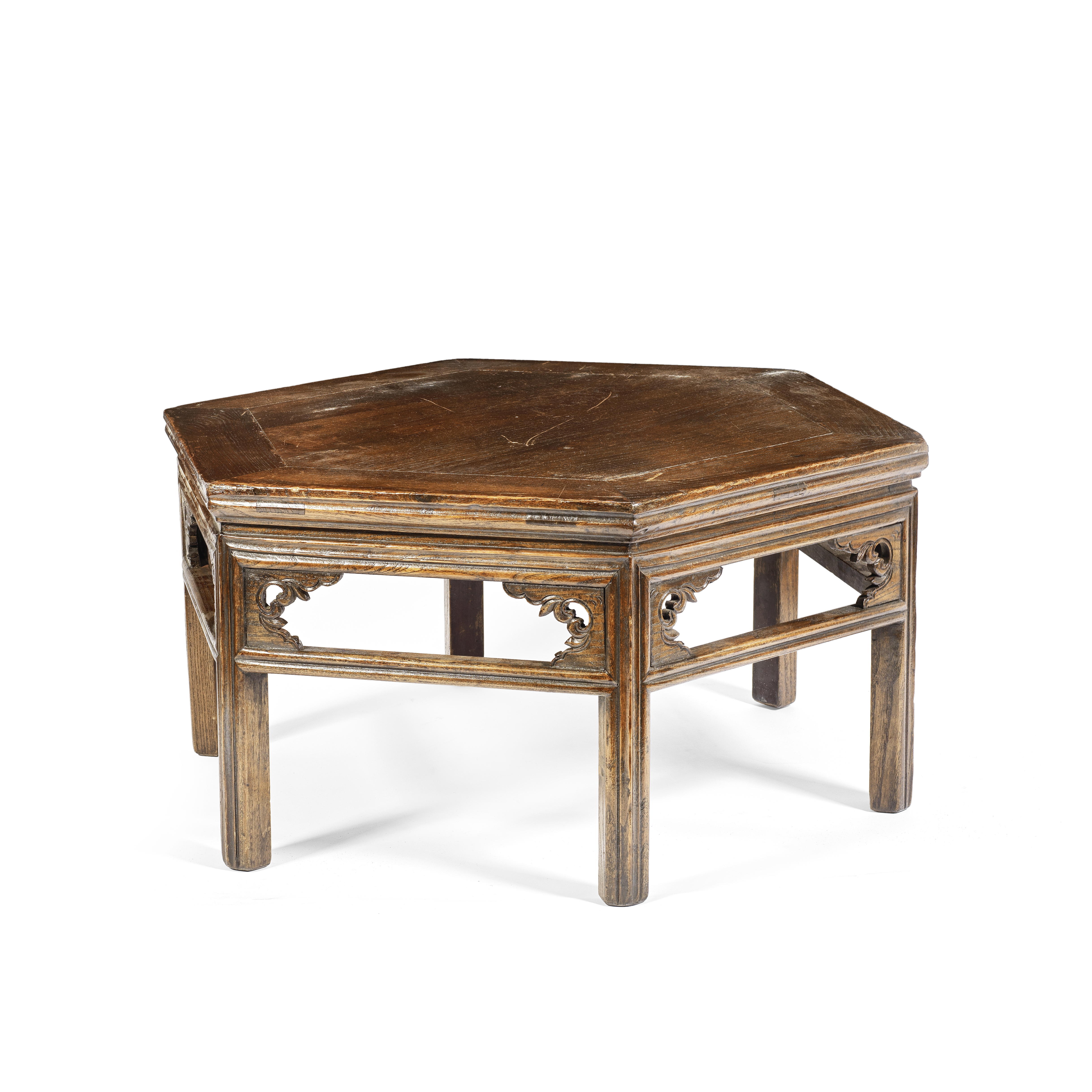 A HEXAGONAL ELMWOOD LOW TABLE 19th century