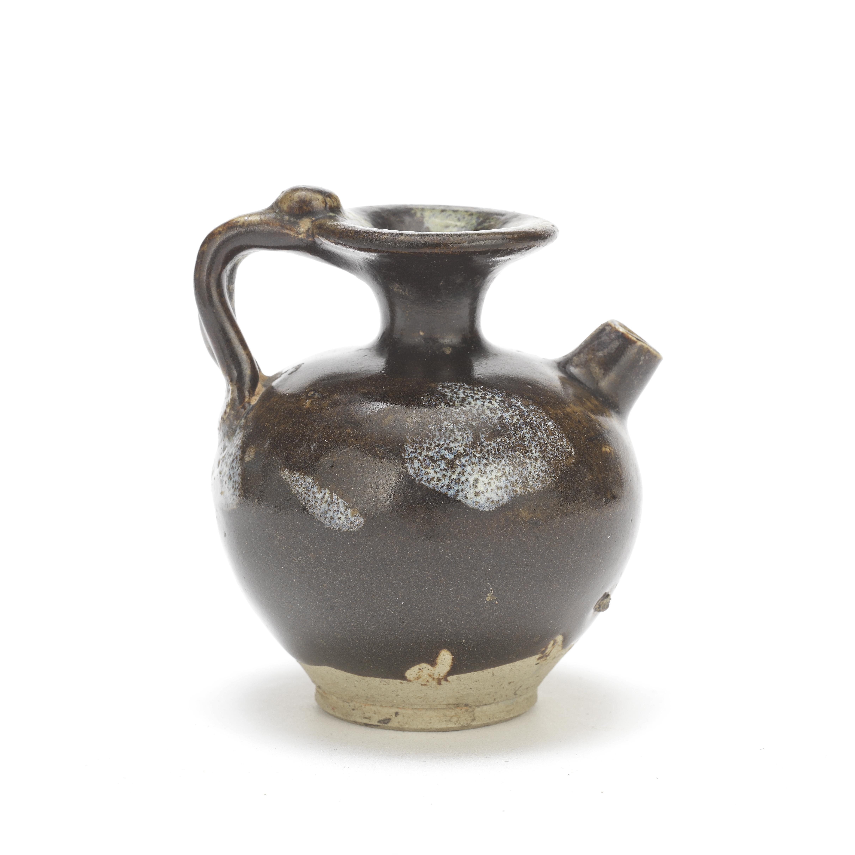 A PHOSPHATE-SPLASHED BROWN-GLAZED EWER Probably Tang Dynasty