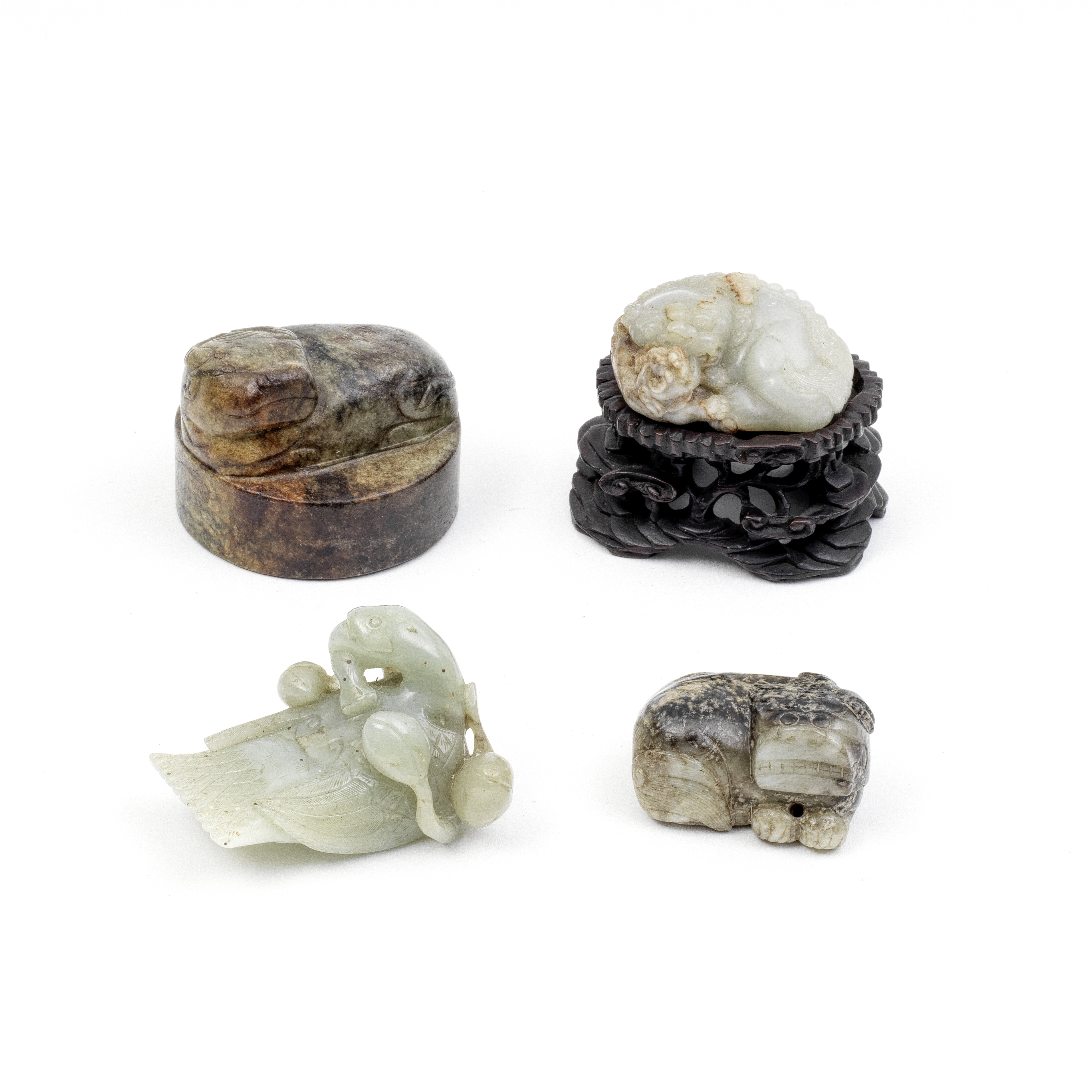 A GROUP OF THREE JADE ANIMALS AND ONE LARGE SEAL 19th and 20th century (5)