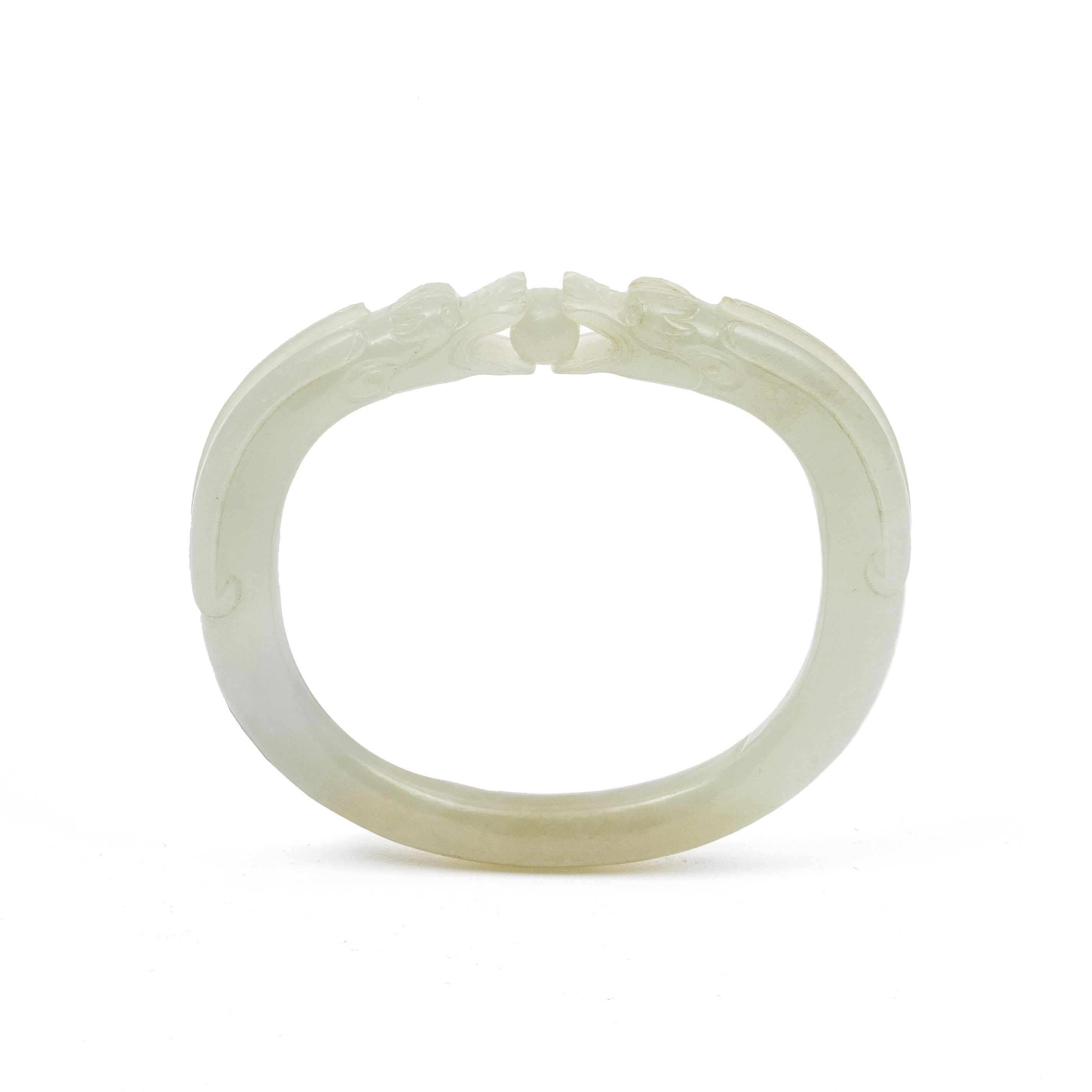 A PALE GREEN JADE 'DOUBLE DRAGON' BANGLE Qing Dynasty