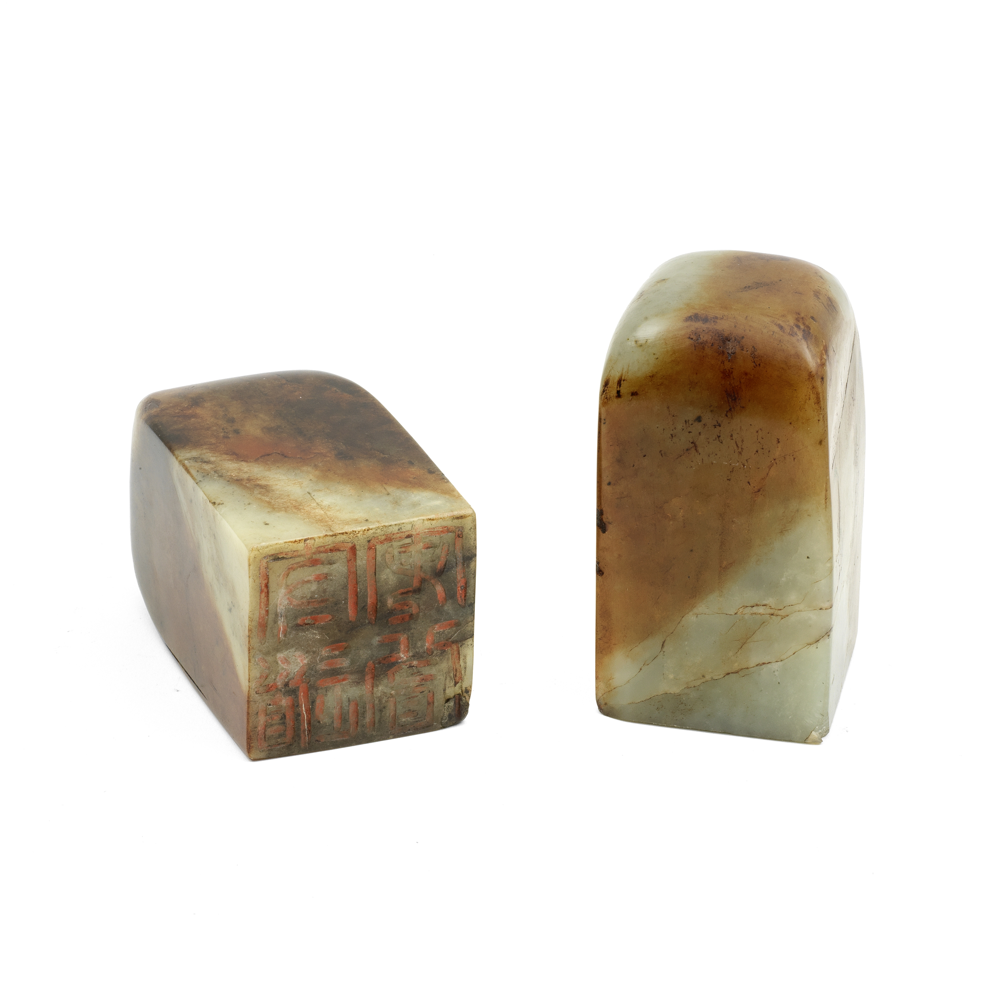 A PAIR OF PALE GREEN AND RUSSET JADE SEALS 20th century (2)
