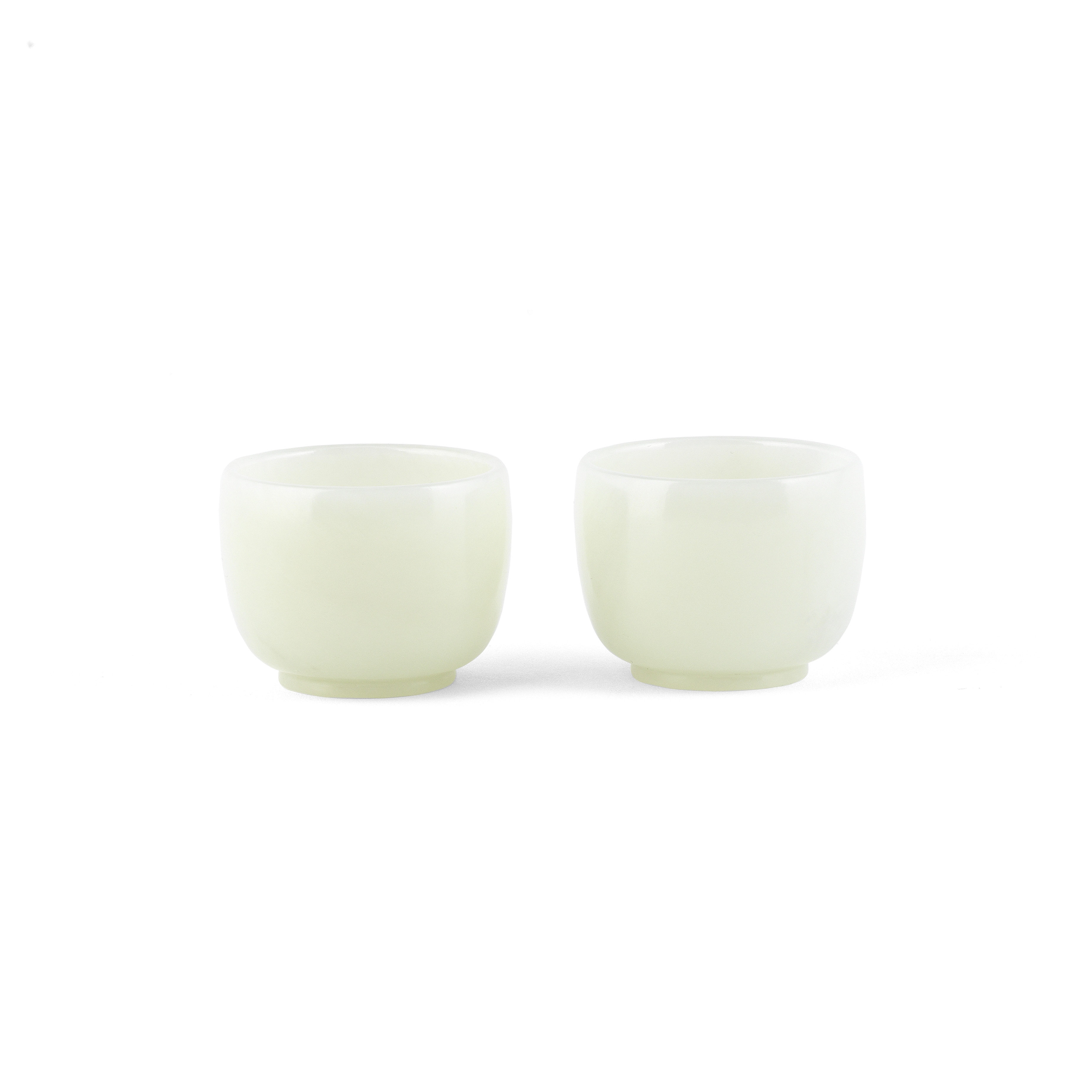 A PAIR OF PALE JADE CUPS 18th/19th century (2)