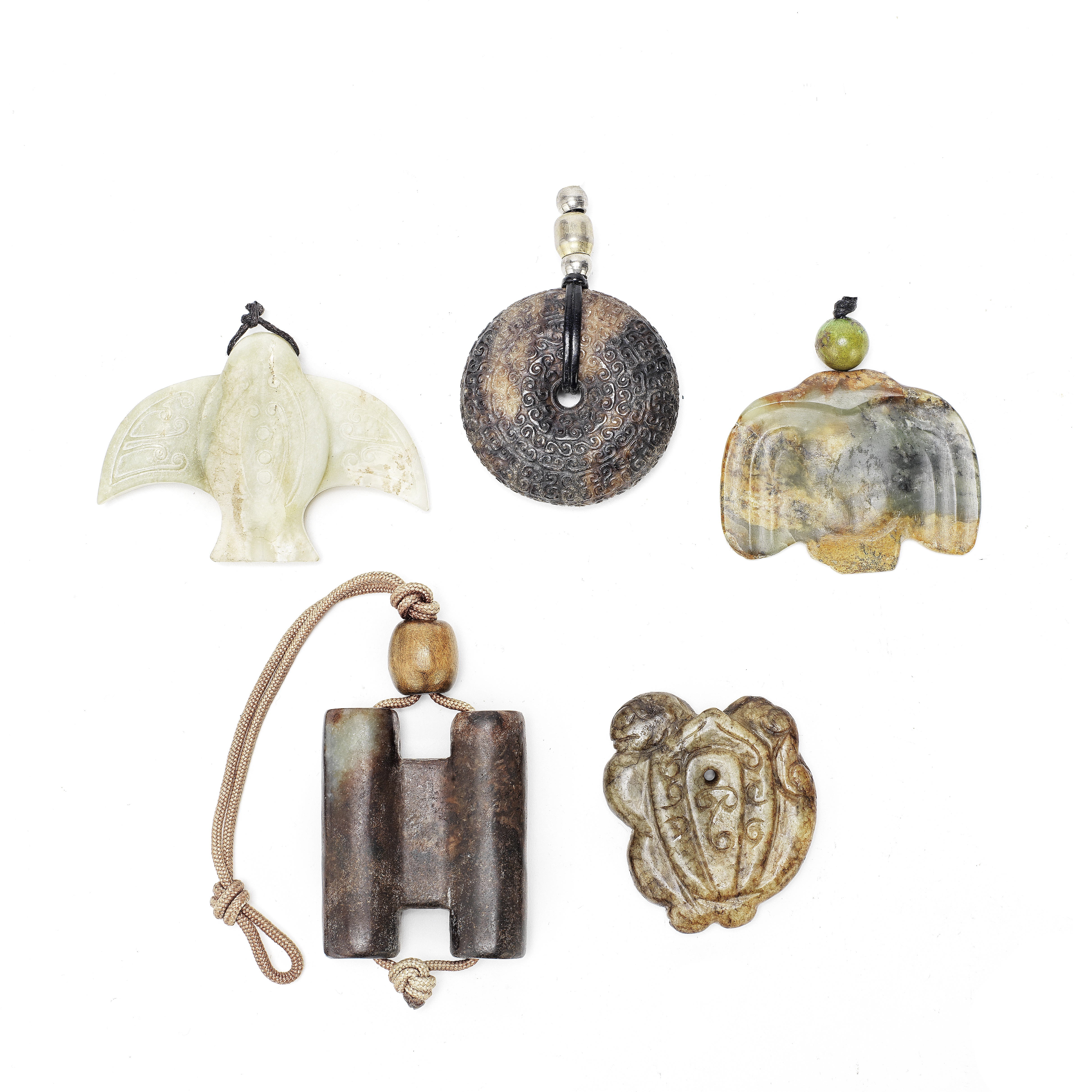 A GROUP OF FIVE ARCHAISTIC PENDANTS (5)