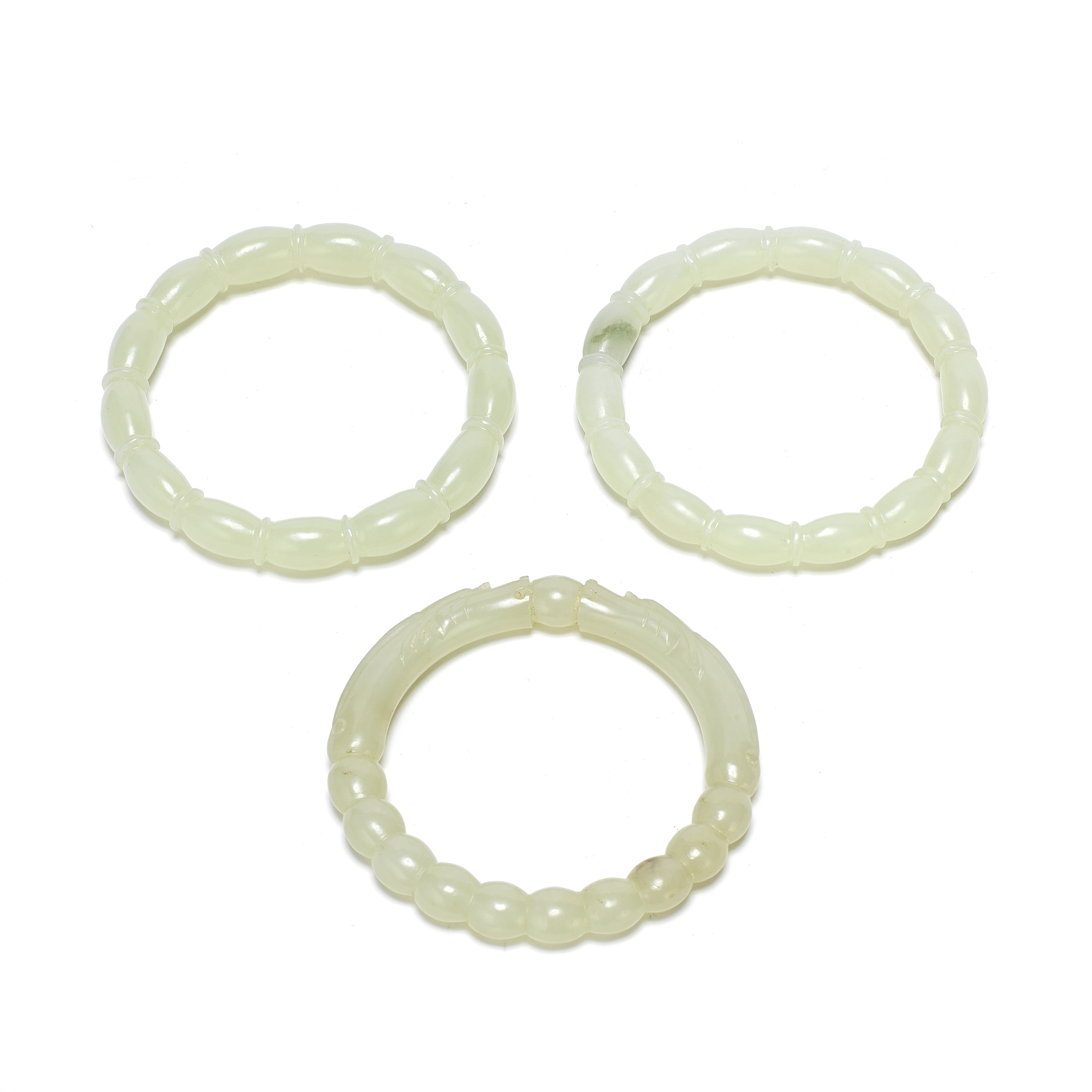 A GROUP OF THREE PALE JADE BANGLES (3)