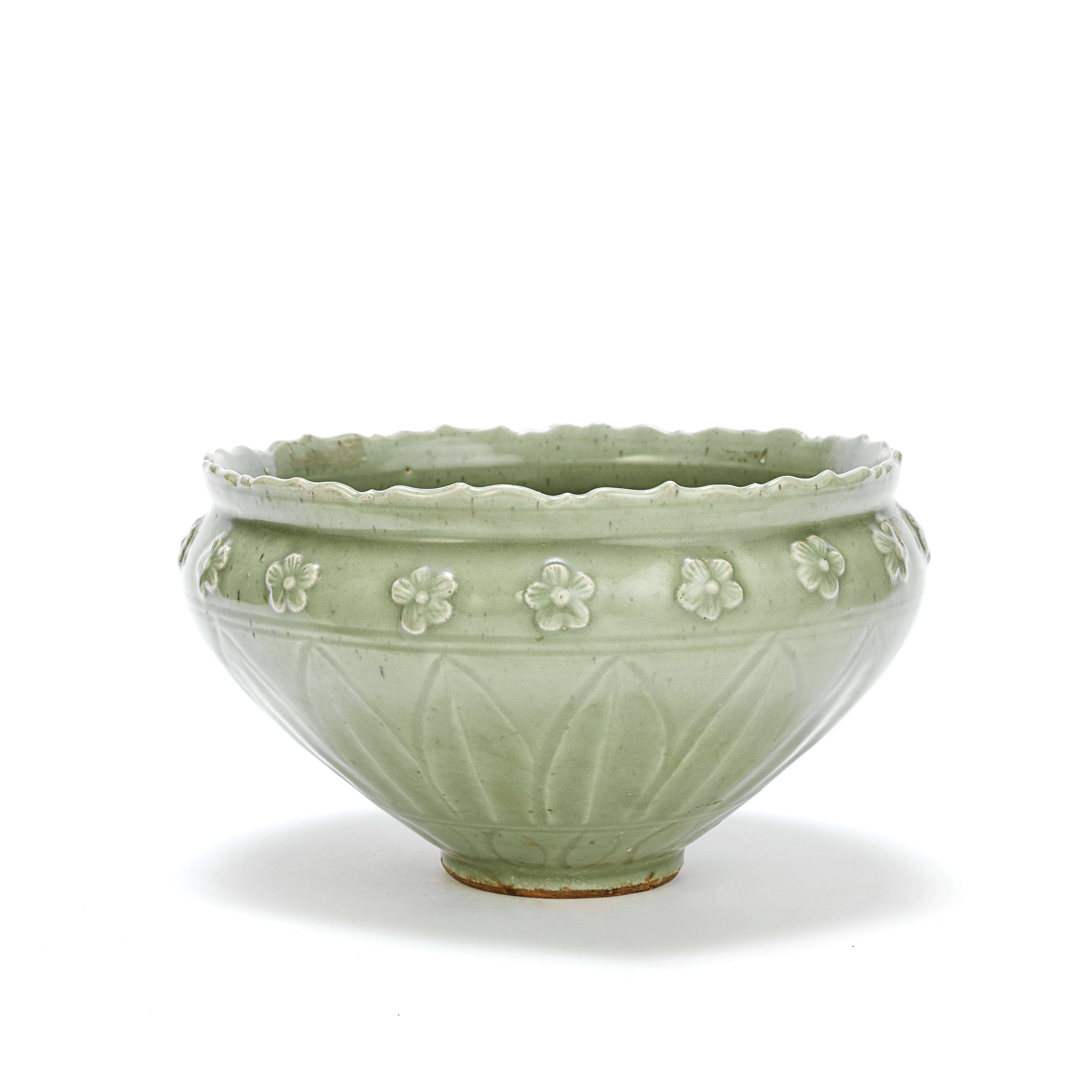 AN UNUSUAL LONGQUAN CELADON-GLAZED CONICAL 'LOTUS AND PRUNUS' BOWL Ming Dynasty