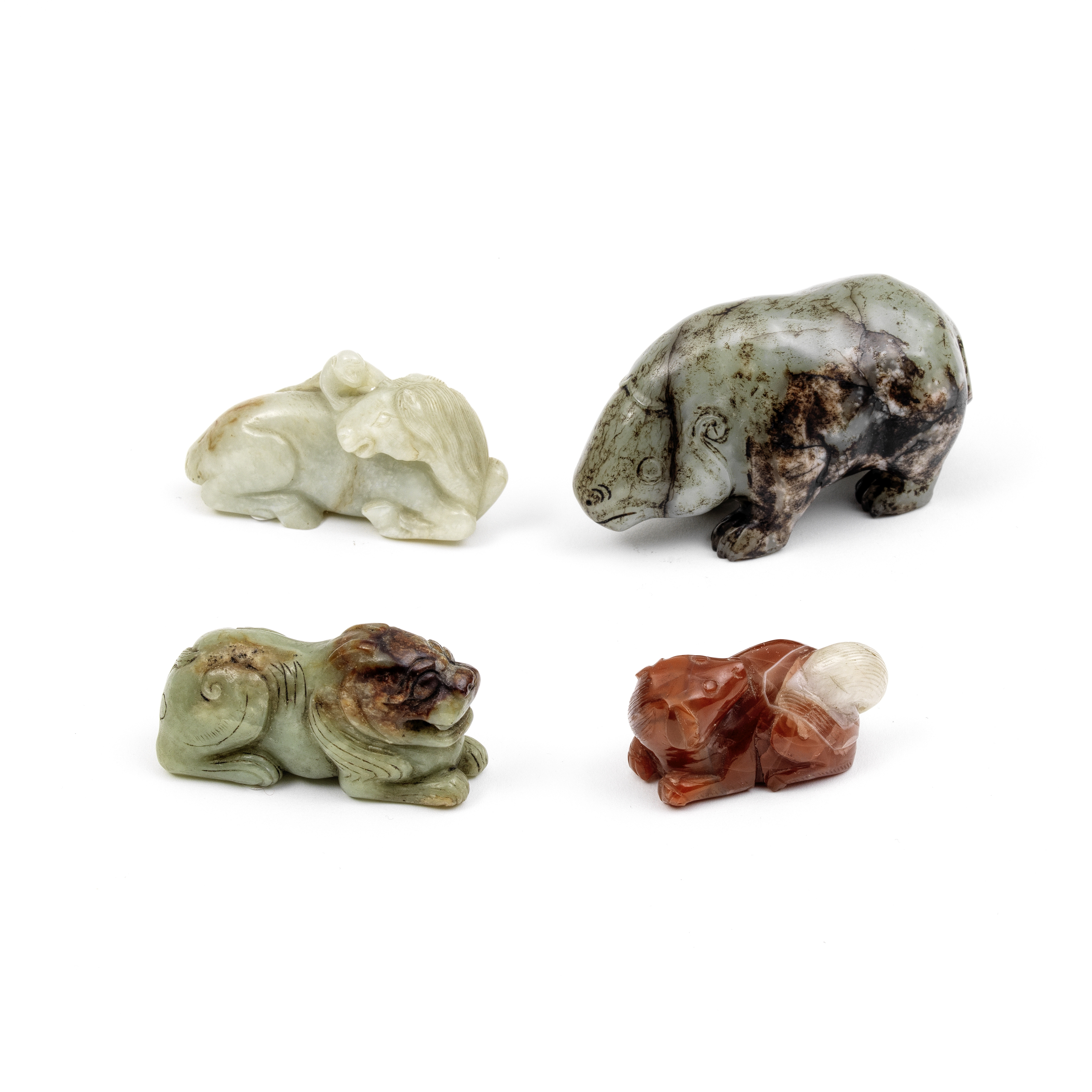 A GROUP OF THREE JADE AND ONE AGATE CARVING OF ANIMALS 19th century and later (4)