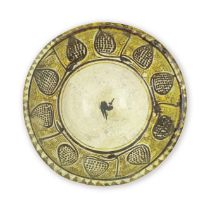 A large Nishapur 'yellow staining black' slip-painted pottery bowl Persia, 10th Century