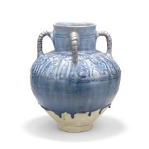 A Kashan moulded monochrome pottery vase Persia, 12th Century