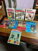 8 Various vintage Football annuals and books. Includes Football Book 1985, Tiger Roy of the