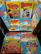 A Lot of 8 vintage Beano annuals dated 1980, 82,83,85,86,87,88 & 89.