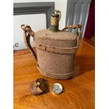 A Military style water flask with leather straps and original cork together with a vintage compass