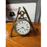 Antique Civil War inspired clock. Designed with a sword , bugle, wreath, rifle and clock incased