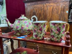 A Royal Albert Old Country Roses 'Chintz Collection' tea pot and four mugs.