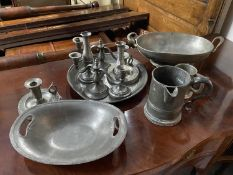 A Selection of 18th/ 19th century pewter items to include candle holders, pouring stein and