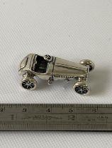 A Silver Morgan style car sculpture/ Figure. [3.5cm in length]