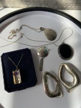 A lot of various silver jewellery to include; Native American style pendant, black onyx pendant