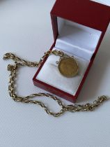 A 9ct gold 1/2 sovereign, dated 1905, with a 9ct gold casing and a 9ct gold belcher chain [length