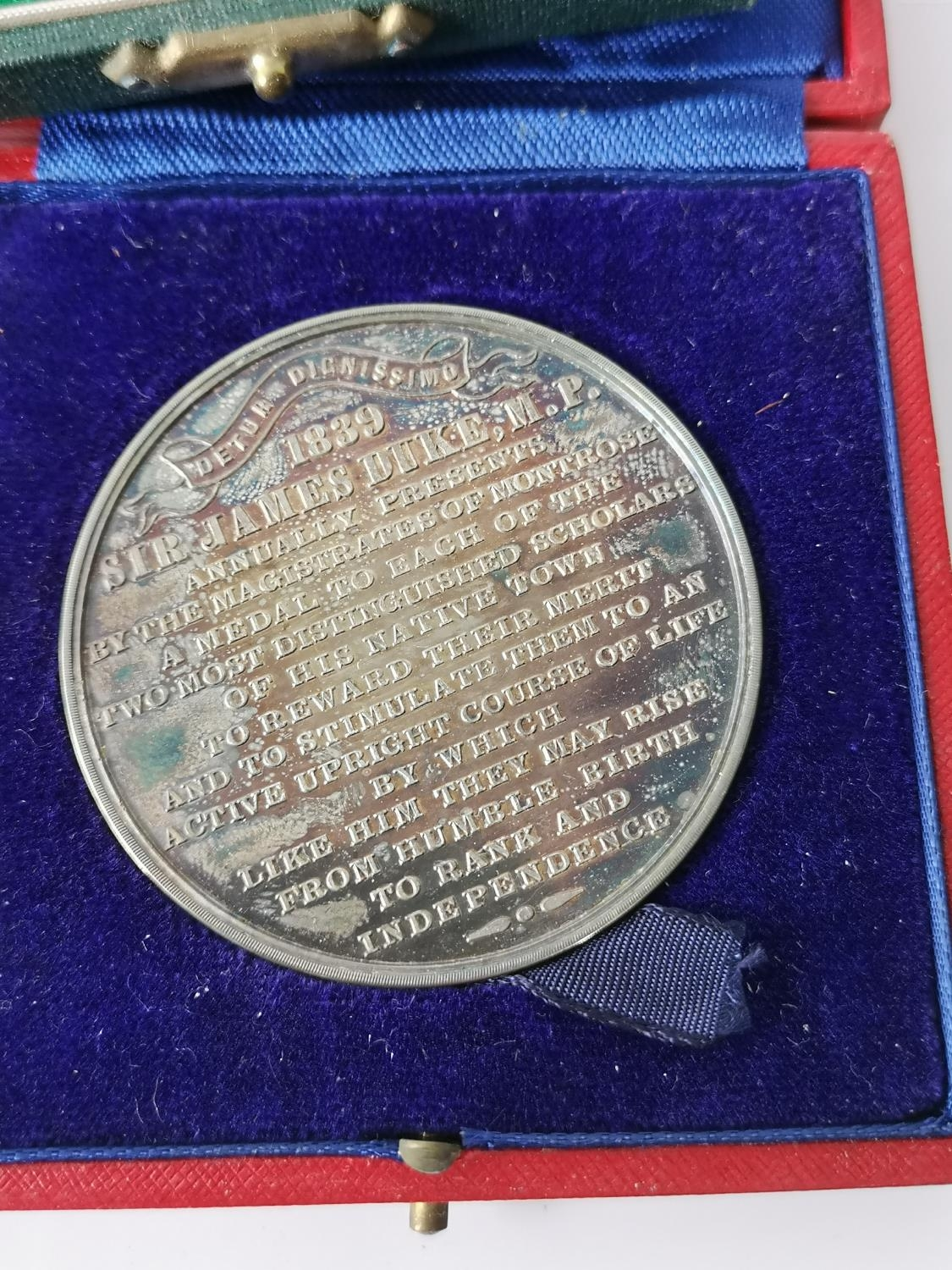 An Edinburgh silver Montrose Academy Dux medal produced by Hamilton & Inches, Comes with a fitted - Image 6 of 7
