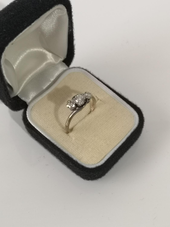 AN 18CT GOLD & PLATINUM DIAMOND THREE STONE RING. [RING SIZE L] [2.66GRAMS]
