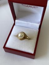 A ladies 14k gold ring set with a single pearl setting, stamped [K14], [3.60g] [size L]