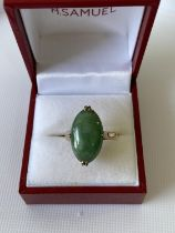 An 18ct gold & jade ring [5.44g] [M 1/2] stamped [18k]
