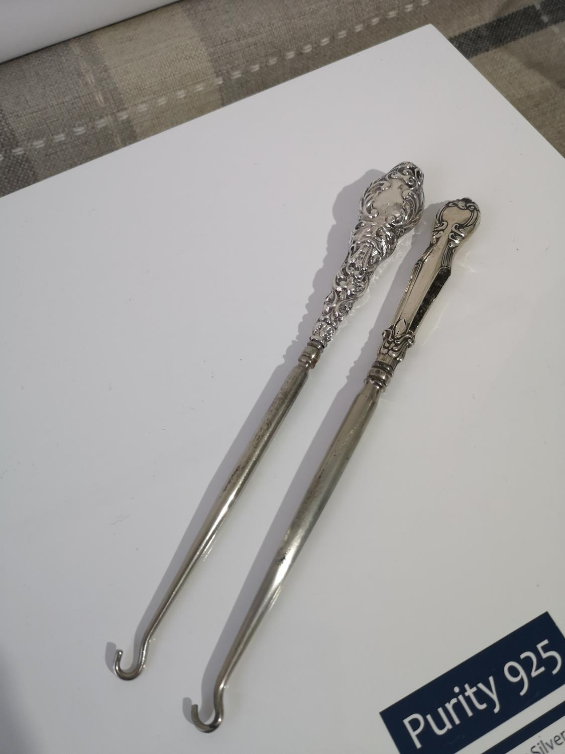 TWO SILVER HANDLE BUTTON HOOKS. SHEFFIELD ISAAC ELLIS AND SONS 1910 & BIRMINGHAM G & C L DATE 1909.