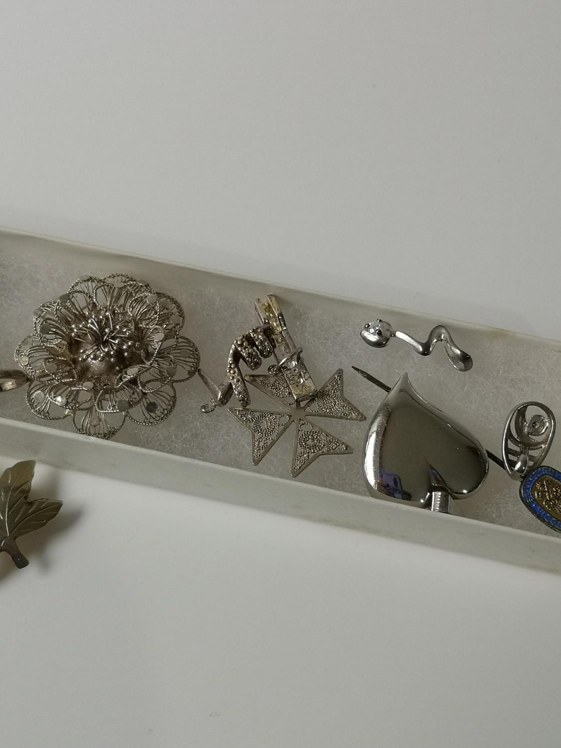 A Collection of silver marked brooches, charms and pendants. - Image 4 of 4
