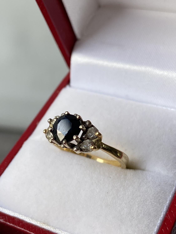 An 18ct gold ladies sapphire & diamond set ring [diameter 6mm] [size M] [2.89g]