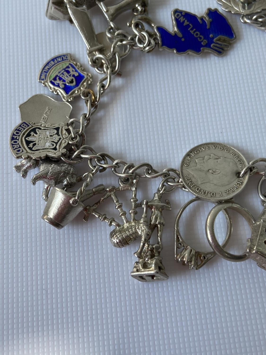 A silver charm bracelet fitted with 23 various silver chains, includes silver & enamel charms [ - Image 5 of 8